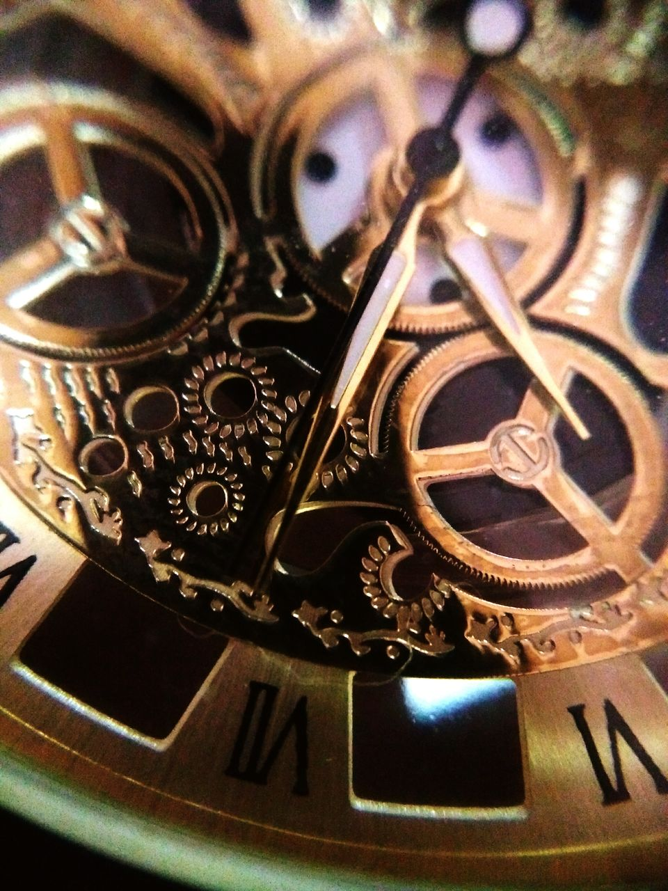 close-up, metal, time, watch, indoors, no people, clock, still life, equipment, number, instrument of time, pattern, machinery, technology, machine part, selective focus, high angle view, focus on foreground, gold colored, complexity, personal accessory