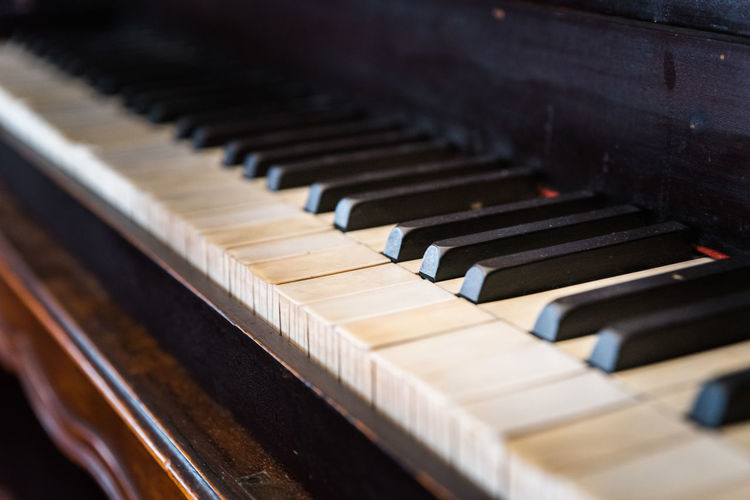 Arts Culture And Entertainment Black Color Close-up In A Row Indoors  Keyboard Keyboard Instrument Music Musical Equipment Musical Instrument No People Old Piano Piano Key Selective Focus Still Life String Instrument White Color Wood - Material