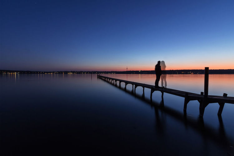 Couple Dreaming Longing Love Missing You Beauty In Nature Blue Clear Sky Day Full Length Horizon Over Water Nature One Person Outdoors People Real People Reflection Scenics Sea Silhouette Sky Sunset Tranquil Scene Tranquility Water