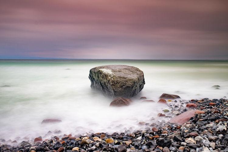 Boulders at flintstone pebbles beach. typical chalk cliff of shore. mecklenburg  pomerania, germany