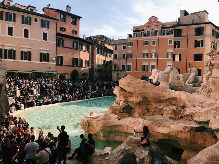 Huge crowd around the famous trevi fountain ⛲️ Crowd Crowd Of People Fontana Di Trevi Trevi Fountain Italy Rome Fountain Building Exterior Crowd Architecture Built Structure Large Group Of People Group Of People City Real People Building Sky Day Outdoors Streetwise Photography
