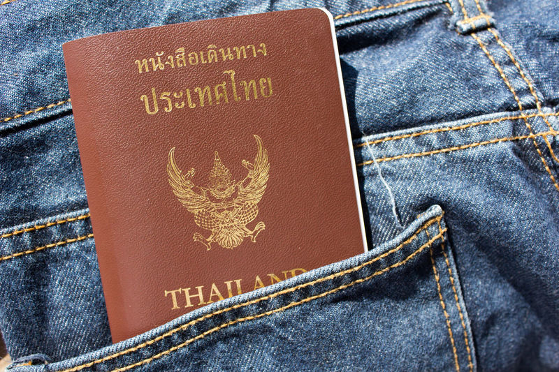 Close-up of thai passport in jeans pocket