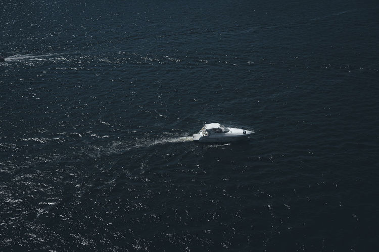 High Angle View Of Motorboat Sailing On Sea