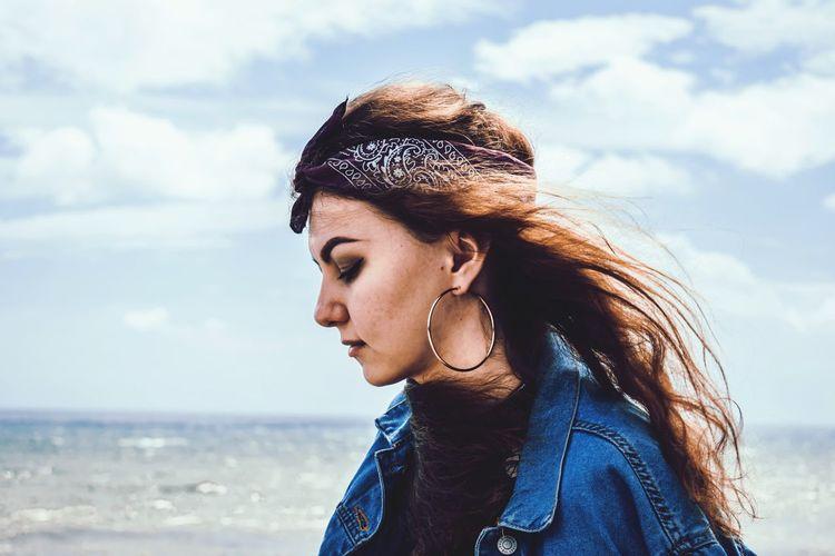 Beautiful woman wearing bandana against sea at beach