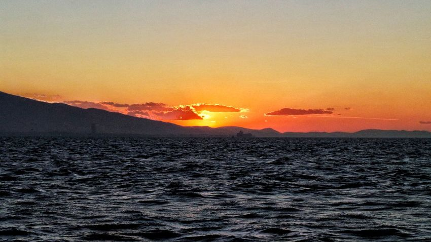 Sunset Beauty In Nature Water Sky Sun Nature Dramatic Sky Sea Mountain No People 🌅 Sunset 🌅⛵📷