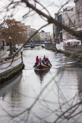 Boat With Tourists In Canal At City