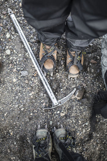 Hiking Spikes Close-up Day High Angle View Human Body Part Human Leg Low Section Manual Worker Occupation Outdoors People Real People Shoe Standing Working