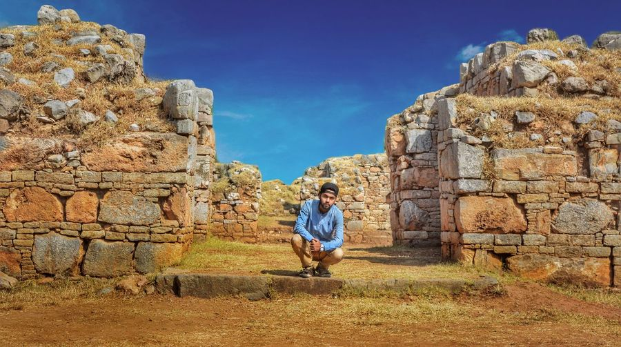 Young Man Near Old Ruins