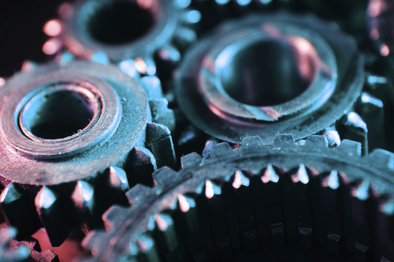 Mechanical Gears with Colored Lighting - Note lots of dirt, grit and grunge. Colors Industry Machinery Mechanical Teamwork Close-up Cogs Concept Connection Cooperation Details Gear Gears Lighting Machine Part Metal Team Togetherness