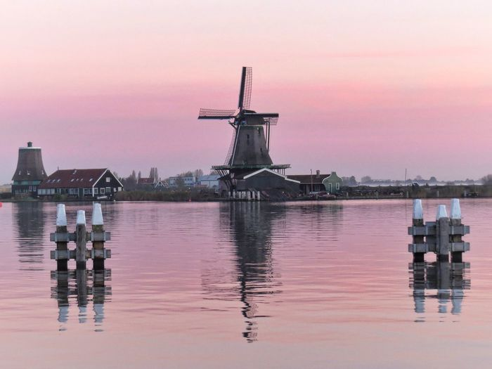 Architecture Beauty In Nature Built Structure Calm Cloud - Sky Holland Idyllic Illuminated Nature No People Orange Color Outdoors Pink Color Rippled Scenics Sky Sunset Tourist Attraction  Tranquil Scene Tranquility Water Waterfront Wooden Post Zaanse Schans Postcards