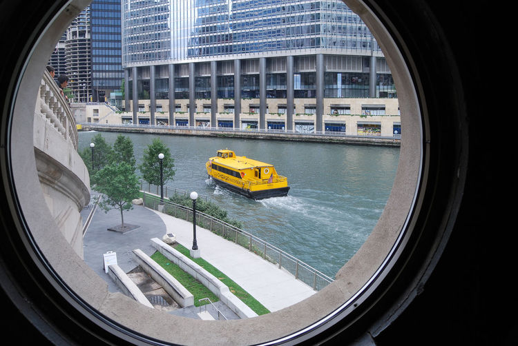 Nautical Vessel Moving On River Seen Through Window