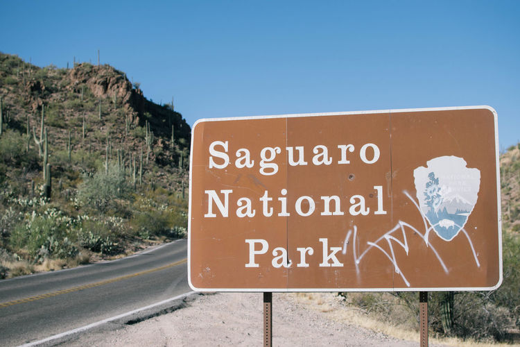 Arizona Desert Saguaro National Park Clear Sky Communication Day Mountain Nature No People Outdoors Road Road Sign Saguaro Text Transportation