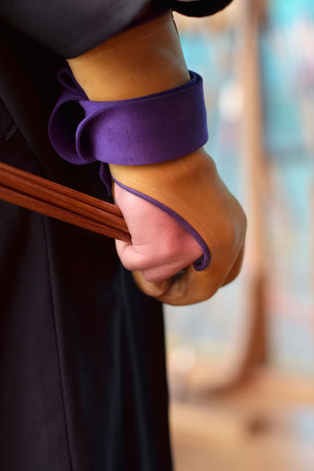 Kyudo archer ready to shoot, ya (arrows) in hand protected by gake (glove) Archery Arrow Gake Glove Japanese Culture Kyudo Martial Arts Ya