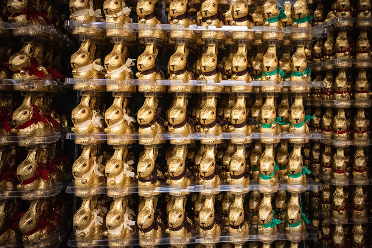 Easter Easter Bunny Large Group Of Objects Choice Retail  In A Row No People Variation Order Abundance Arrangement Full Frame Store For Sale Retail Display Indoors  Backgrounds Sale Sweet Food Chocolate Golden Color Bell