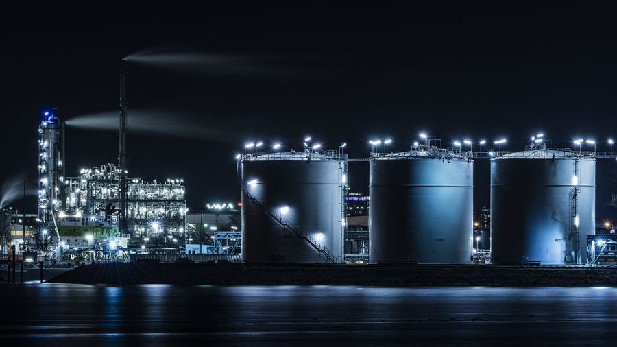 Illuminated industrial building at night