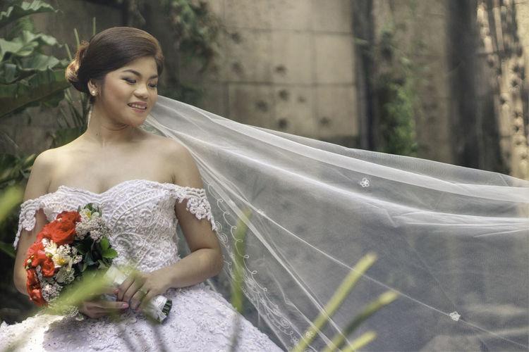 Portrait Of Happy Bride Outdoors