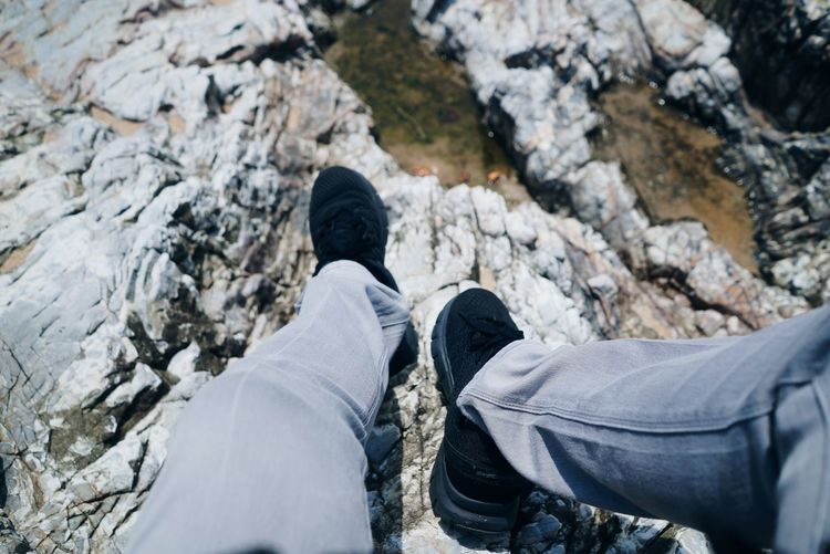 Going Down Low Section Shoe Rock - Object Personal Perspective Human Leg Human Body Part One Person Jeans Real People Day Outdoors Leisure Activity Standing Lifestyles Men Nature People Adult Close-up Adults Only
