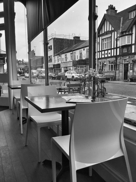Table Chair Restaurant Cafe Outdoor Cafe Day Architecture Built Structure No People Indoors  Building Exterior Sky IPhoneography JoMo Photo Blackandwhite Black And White Street Photography Streetphotography Liverpool