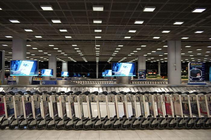 Conveyor Belt Suvarnabhumi Airport The Week On EyeEm Trolley Airport Arrival Hall Baggage Carousel Baggage Cart Baggage Claim Baggage Trolleys Cart Indoors  Light Fixture No People Pattern Rows Colour Your Horizn