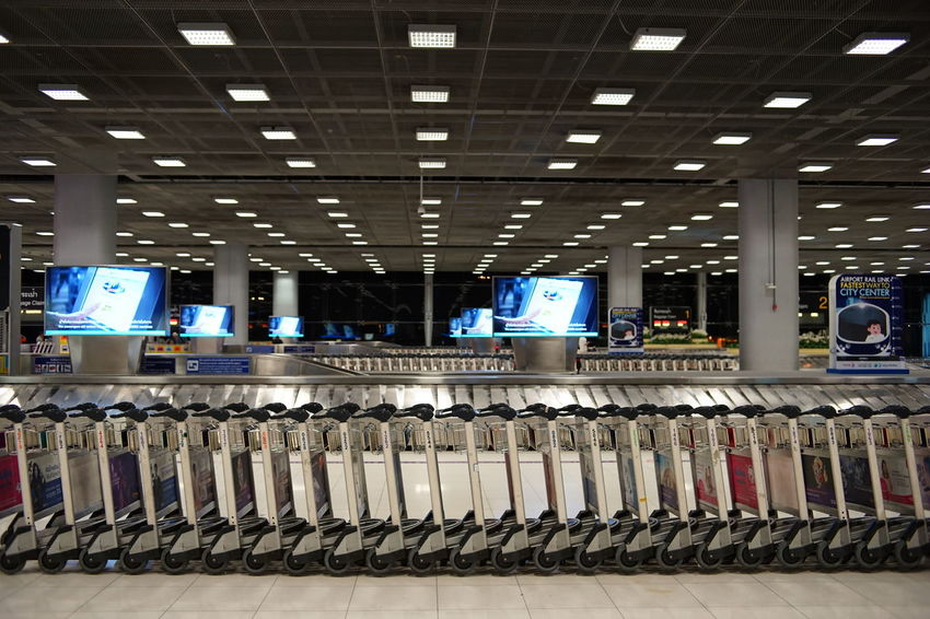 Conveyor Belt Suvarnabhumi Airport The Week On EyeEm Trolley Airport Arrival Hall Baggage Carousel Baggage Cart Baggage Claim Baggage Trolleys Cart Indoors  Light Fixture No People Pattern Rows Colour Your Horizn