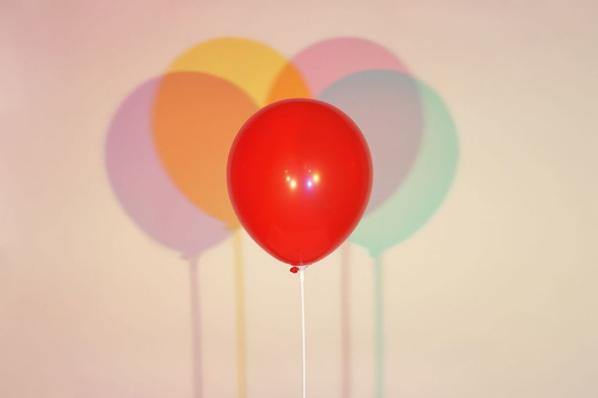 Red balloon and four gelled lights Balloon Balloon Helium Balloon Multi Colored Decoration Indoors  Mid-air Celebration Red Party - Social Event No People