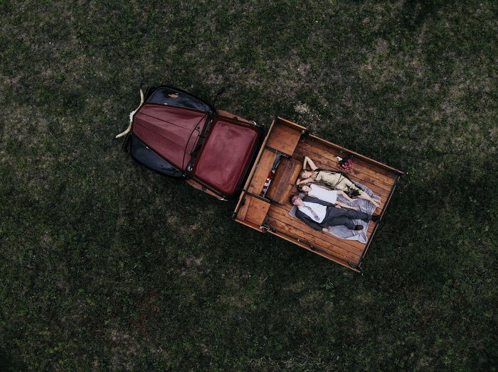 High angle view of old vintage car on field