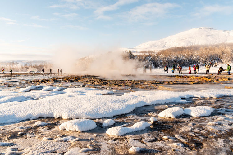 Iceland Iceland Wintertime Smoke - Physical Structure Hot Spring Heat - Temperature Group Of People Geology Steam Geyser Power In Nature Day Physical Geography Water Sky Nature Crowd Winter Snow Large Group Of People Mountain Outdoors