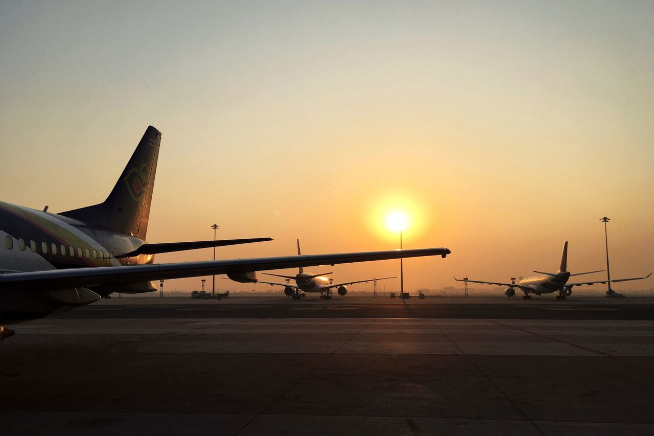 airplane, transportation, sunset, travel, airport, air vehicle, sky, runway, airport runway, journey, sun, no people, aircraft wing, outdoors, commercial airplane, nature, airplane wing, day
