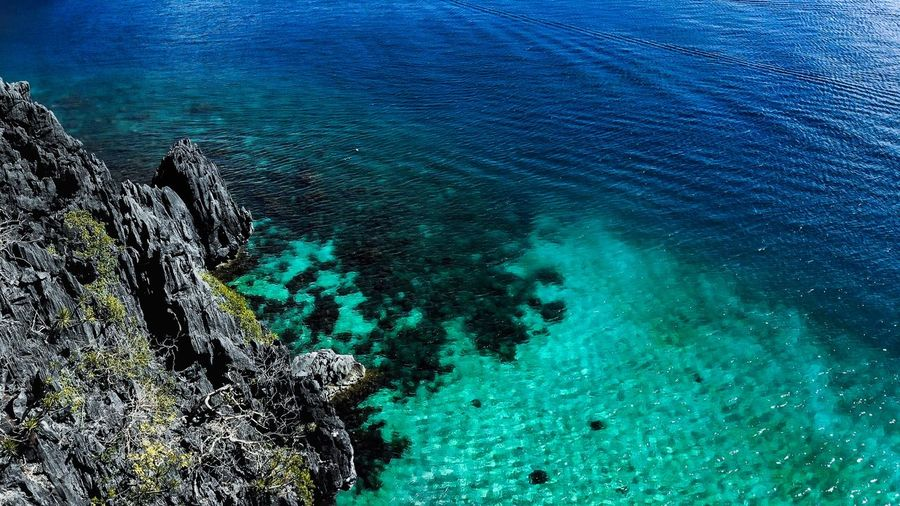 Rocky Shores Aerial View Tropical Water Rocks Beach Water Beauty In Nature Sea Nature High Angle View Blue Turquoise Colored Day Tranquility Scenics - Nature Outdoors Land Tranquil Scene Sunlight