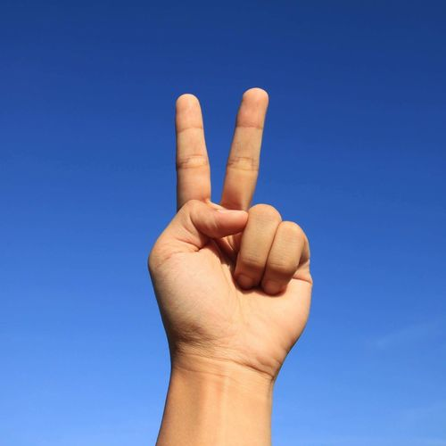 Human Hand Human Body Part Human Finger Gesturing Blue Day Clear Sky One Person Close-up Outdoors Sky People