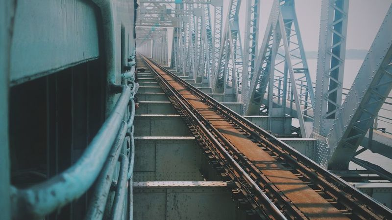 Transportation Railroad Track The Way Forward Built Structure City Rail Transportation Architecture Outdoors No People Day VSCO Vscocam Train People Vscofilm Midsection Favourite Places Lowexposure Low Section Horizontal Personal Perspective River Sky Bridge Tourism