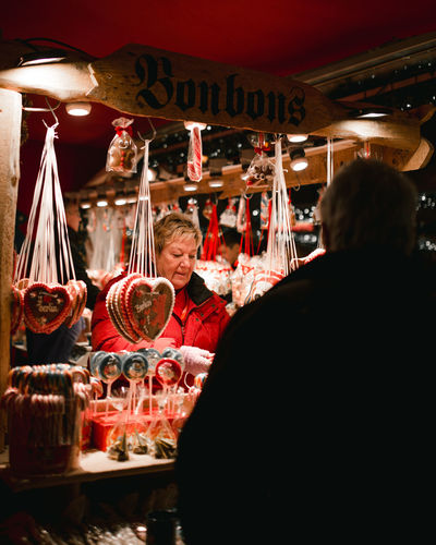 christmas markets Christmas Around The World Business Stories Christmas Market Christmas Light Lights Candy Candyshop Candyshop Cookies Christmas Cookies Bonbons Street Photography Street Portrait Indoors  Night People