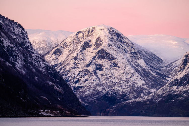 Lake By Snowcapped Mountains Against Sky During Sunset