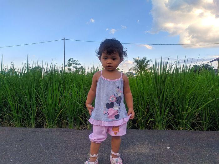 Full length of girl standing on grass
