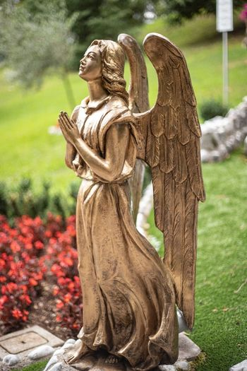 Statue of angel in park