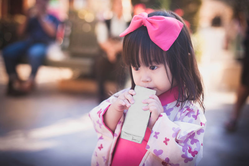 Close-up of girl holding packet