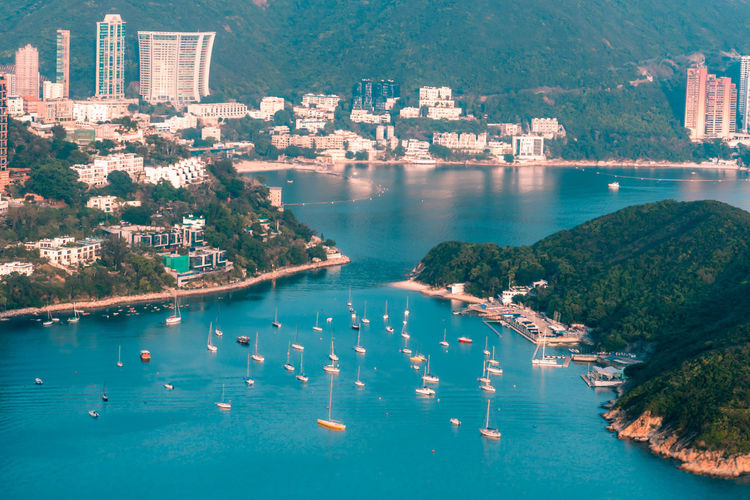 View of boats middle islands buildings in seaside at deep water bay hong kong seen form brick hill