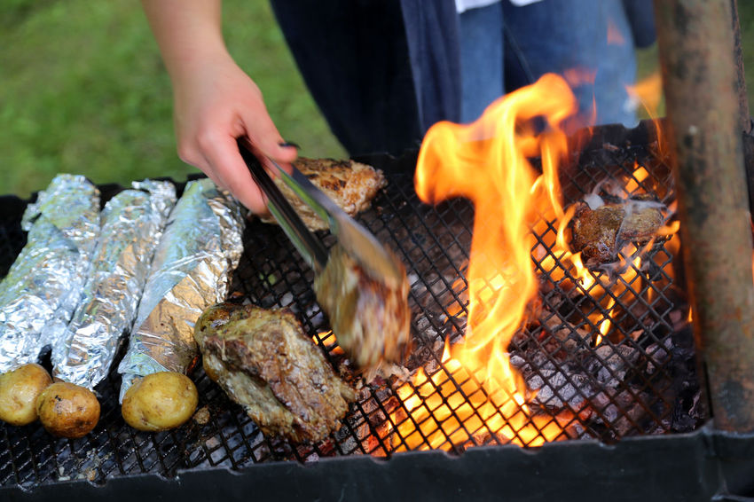 Barbecue Barbecue Grill Burning Coal Day Flame Food Food And Drink Freshness Grilled Healthy Eating Heat - Temperature Holding Human Body Part Human Hand Leisure Activity Meat One Person Outdoors Preparation  Real People Sausage Skewer Smoke - Physical Structure Summer