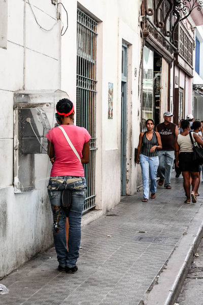 Cuba Call Architecture Building Building Exterior Built Structure Casual Clothing City Cuba Full Length Havana Leisure Activity Lifestyles Payphone Person Rear View Standing Street Streetphotography Walking Young Adult