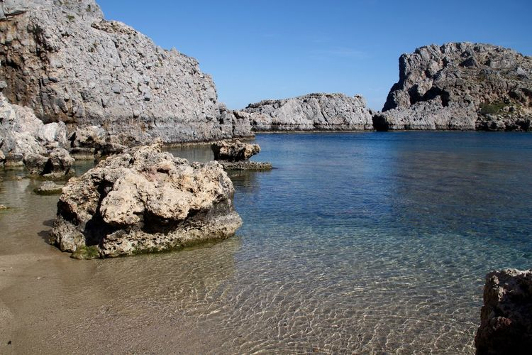 Rhodes Ródos Saint Paul's Bay Beach Beauty In Nature Clear Water Day Lindos Nature No People Outdoors Rock - Object Rock Formation Scenics Sea Tranquil Scene Tranquility Water Perspectives On Nature