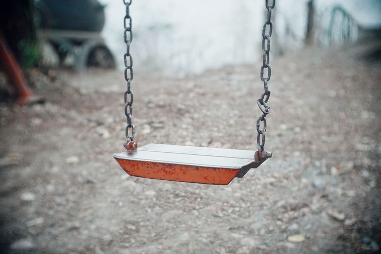 Close-up of empty swing in park