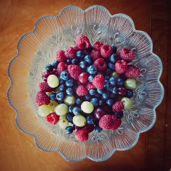 A Delicious Bowl of Blueberries Raspberries and Grapes for Breakfast to Share . Fruit Fruit Bowl Food Food And Drink Healthy Eating Healthy Lifestyle New Years Resolutions 2016 Glass Point Of View Table Ready-to-eat Freshness Dessert High Angle View No People Raspberry Sweet Food EyeEmNewHere
