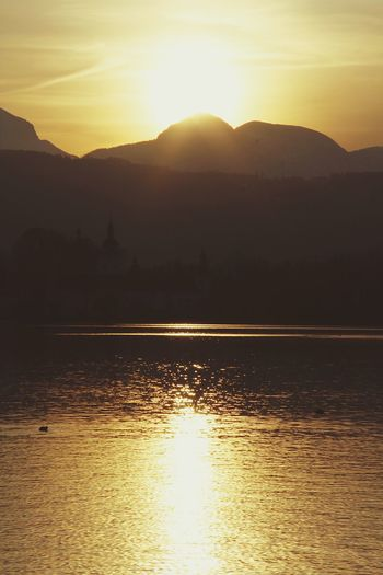 Sunset Sun Mountain Silhouette Beauty In Nature Nature Scenics Tranquil Scene Sunlight Tranquility Sunbeam Water Lake Reflection Mountain Range Idyllic Waterfront No People Outdoors Sky Castle Schlosshotel Orth Schloss