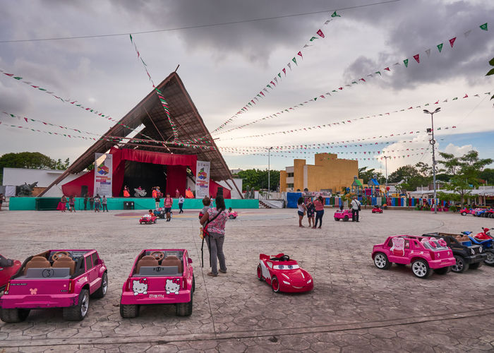 Children's Car Carousel in the square, El Parque de las Palapas, Cancún, Mexico, in September 8, 2018 8, 2018 Cancun Mexico Architecture Building Exterior Built Structure Car Carribean Cloud - Sky Day Decoration Group Of People Incidental People Land Vehicle Men Mode Of Transportation Motor Vehicle Nature Outdoors People Real People Red Sky Transportation