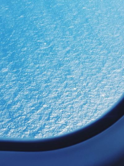 Sea from airplane window Airplane Window Sea Ocean Light Sun Glistening Water No People Blue Nature Day Pattern Full Frame EyeEm Ready   EyeEm Ready