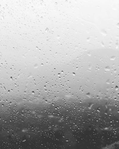 Full frame shot of wet glass window