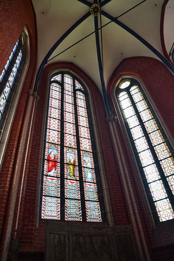 Münster Bad Doberan innen Münster Bad Doberan Innenansicht Kirchenschiff Window Glass Glass - Material Place Of Worship Indoors  Low Angle View Belief Architecture Built Structure Religion Stained Glass Spirituality Building No People Arch Day Transparent Ceiling Ornate