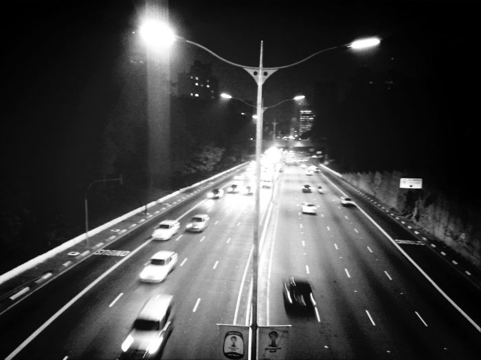 Cars moving on road at night