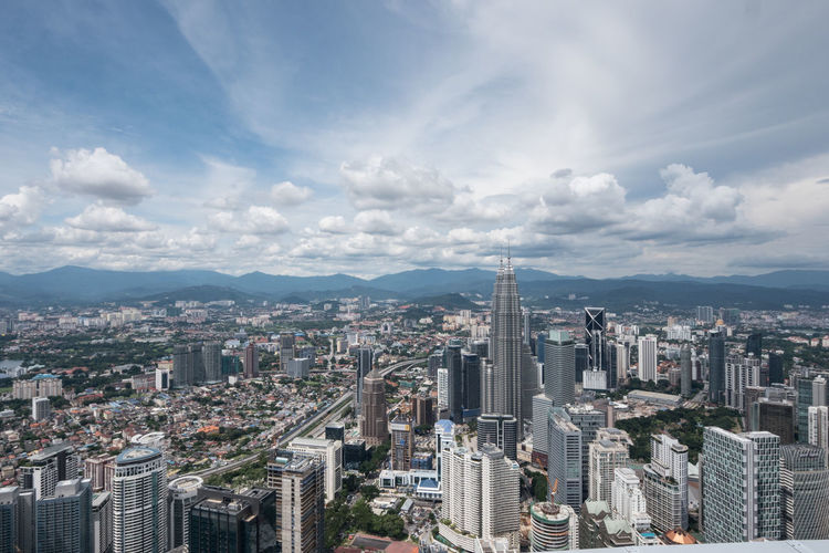 Petronas towers in city seen from menara kuala lumpur tower