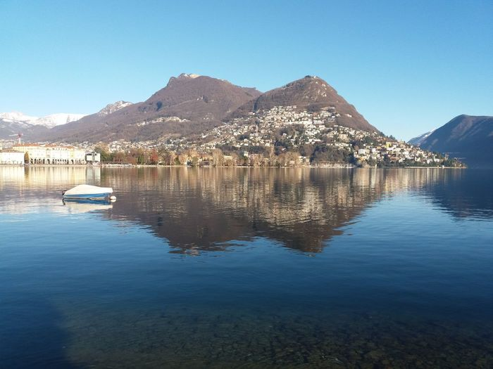 lakeview in Lugano Water Mountain Sky Tranquility Scenics - Nature Reflection Waterfront Tranquil Scene Beauty In Nature Blue Mountain Range No People Clear Sky Lake Nature Day Copy Space Idyllic Outdoors Lugano, Switzerland